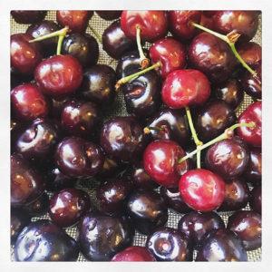 A colander of fresh cherries