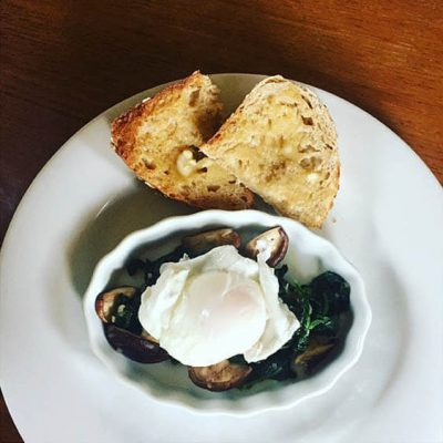 On a rainy spring morning we can't think of a better way to start the day than with a perfectly poached egg over spinach. Don't forget the Tartine toast!